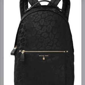 michael kors kelsey black cheetah backpack